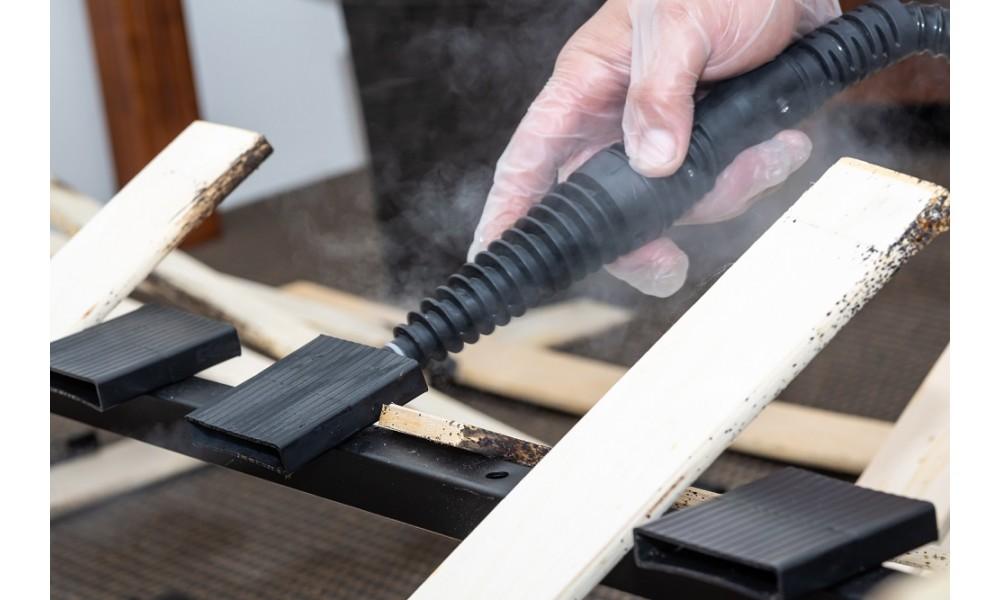 Bed Bug Steamer treating bed frame